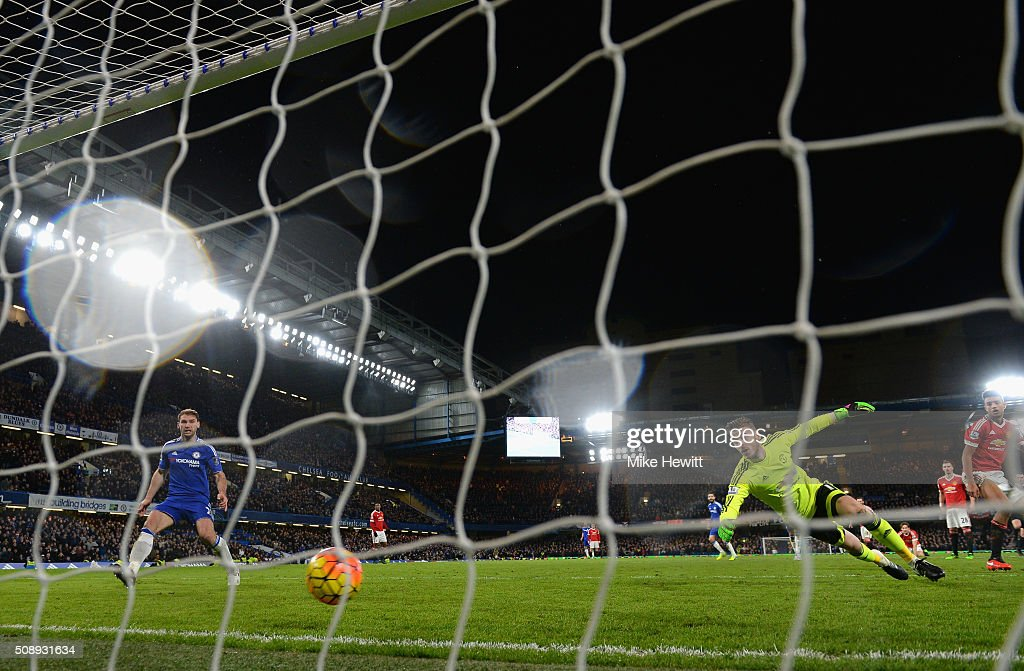 David De Gea of Manchester United attempts to save Diego Costa of Chelsea scoring the equalising goal during the Barclays Premier League match between Chelsea and Manchester United at Stamford Bridge on February 7, 2016 in London, England.