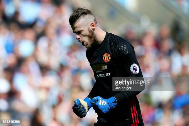 David De Gea of Manchester United celebrates after teammate Anthony Martial scored the opening goal during the Premier League match between Burnley...