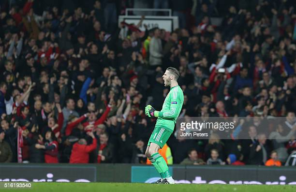 David de Gea of Manchester United celebrates Anthony Martial scoring their first goal during the UEFA Europa League Round of 16 Second Leg match...