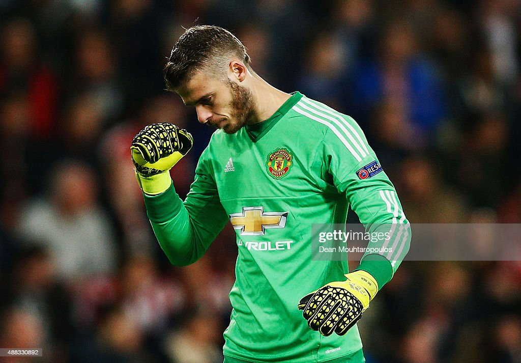 David De Gea of Manchester United celebrates as team mate Memphis Depay (not pictured) scores their first goal during the UEFA Champions League Group B match between PSV Eindhoven and Manchester United at PSV Stadion on September 15, 2015 in Eindhoven, Netherlands.