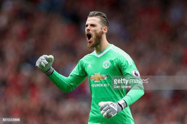 David De Gea of Manchester United celebrates his sides second goal during the Premier League match between Manchester United and West Ham United at...