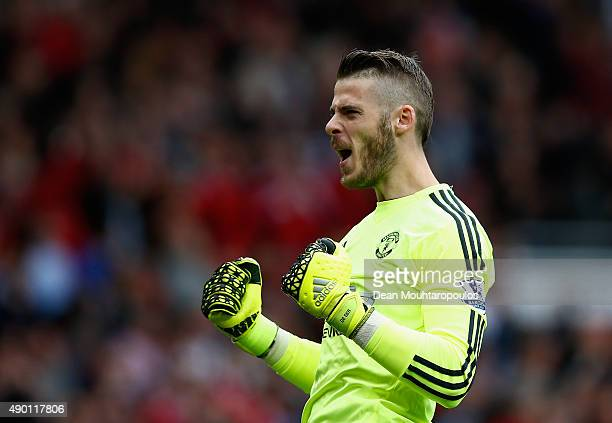 David De Gea of Manchester United celebrates his team's first goal by Memphis Depay during the Barclays Premier League match between Manchester...