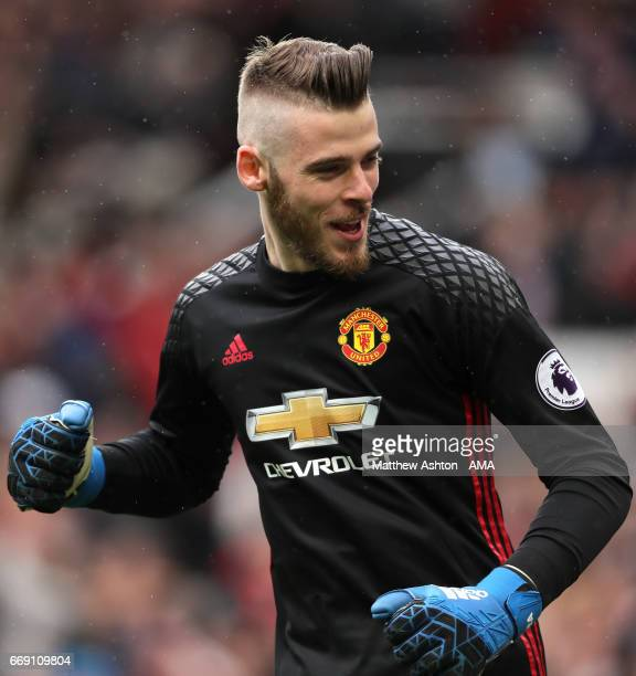 David De Gea of Manchester United celebrates his team's first goal during the Premier League match between Manchester United and Chelsea at Old...