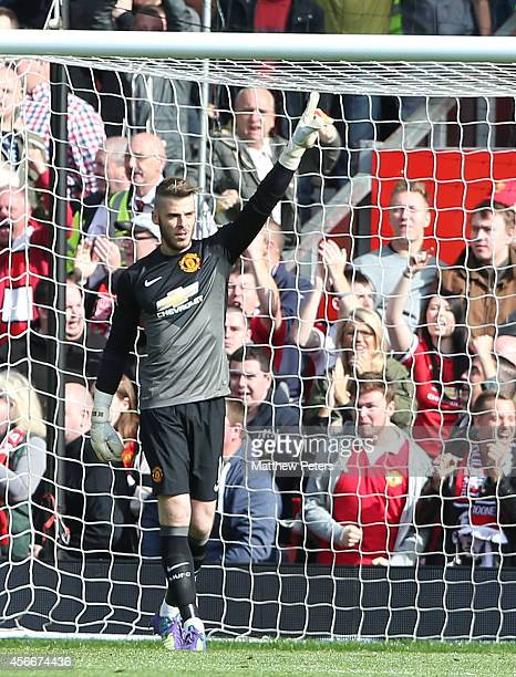David de Gea of Manchester United celebrates saving a penalty from Leighton Baines of Everton during the Barclays Premier League match between...