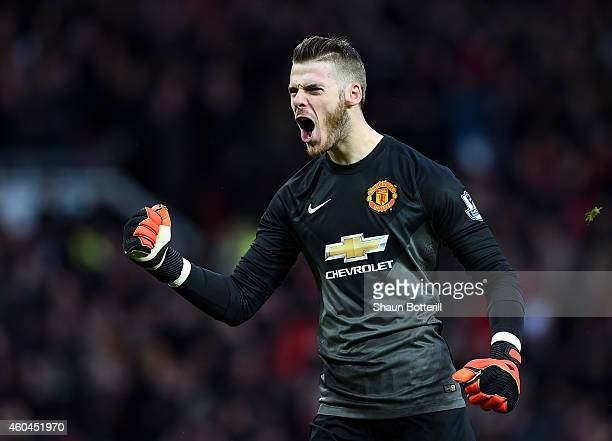 David De Gea of Manchester United celebrates the first goal during the Barclays Premier League match between Manchester United and Liverpool at Old...
