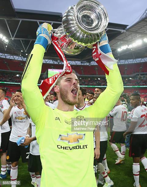 David de Gea of Manchester United celebrates with the FA Cup trophy after The Emirates FA Cup final match between Manchester United and Crystal...