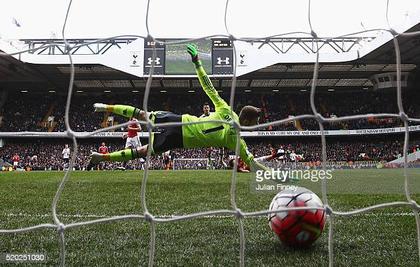 David De Gea of Manchester United dives in vain as Erik Lamela of Tottenham Hotspur socres their third goal during the Barclays Premier League match...