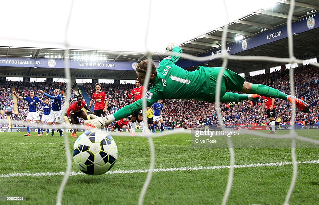 David De Gea of Manchester United dives in vain as Esteban Cambiasso of Leicester City scores his team's third goal from the penalty spot during the...