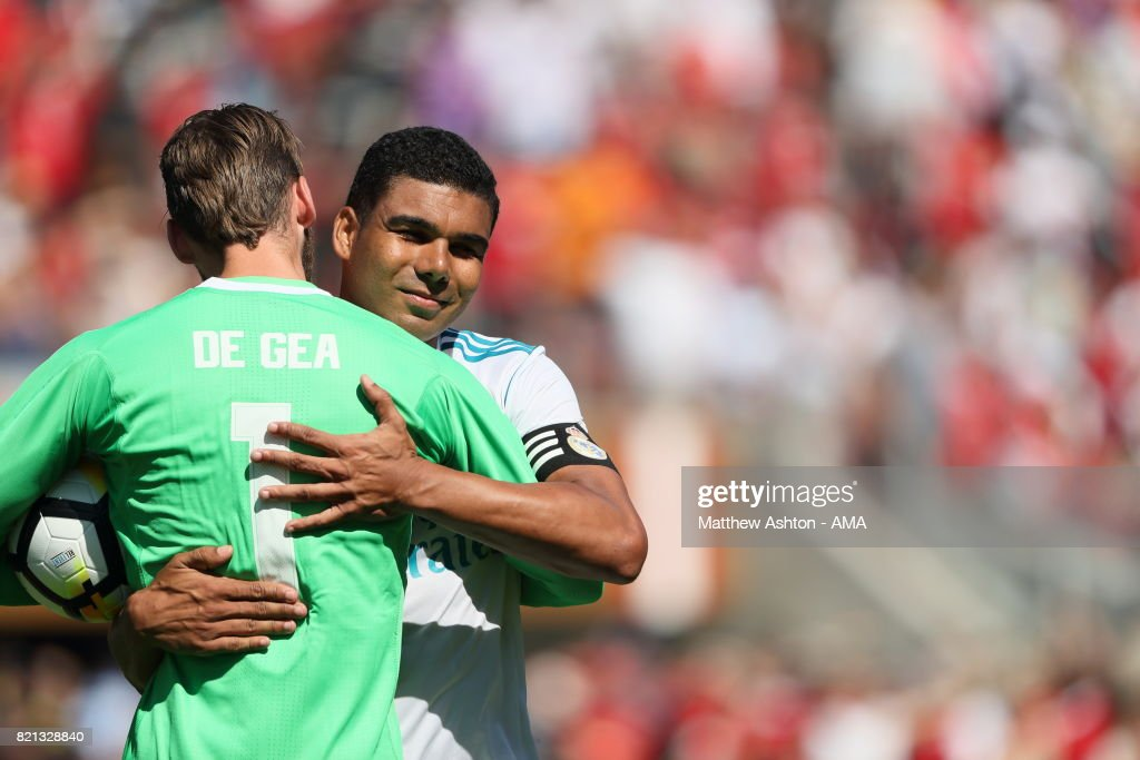 David de Gea of Manchester United embraces Casemiro of Real Madrid after his penalty kick hit the bar resulting in a Manchester United victory during the International Champions Cup 2017 match between Real Madrid v Manchester United at Levi'a Stadium on July 23, 2017 in Santa Clara, California.
