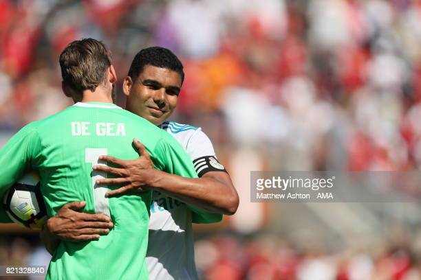 David de Gea of Manchester United embraces Casemiro of Real Madrid after his penalty kick hit the bar resulting in a Manchester United victory during...