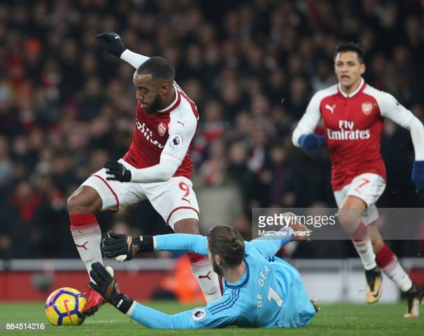 David de Gea of Manchester United in action with Alexandre Lacazette of Arsenal during the Premier League match between Arsenal and Manchester United...