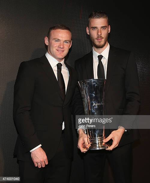 David de Gea of Manchester United is presented with the Players' Player of the Year trophy by Wayne Rooney at the Manchester United Player of the...