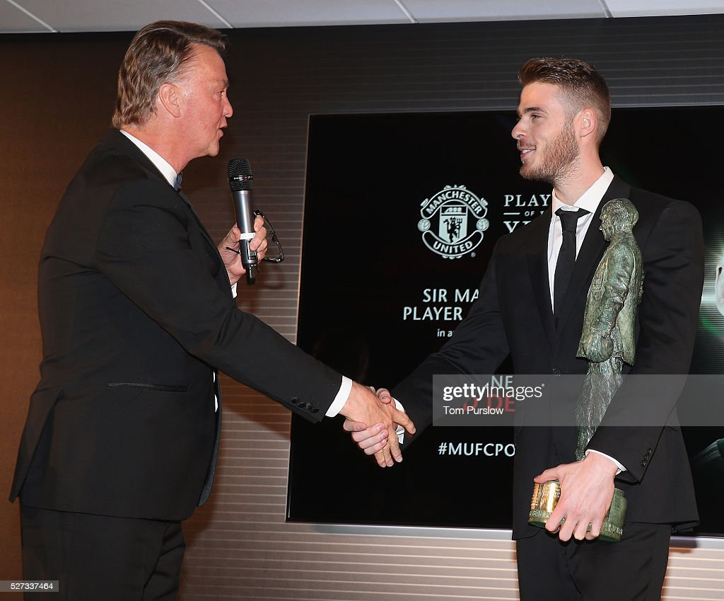 David de Gea of Manchester United is presented with the Sir Matt Busby Fans' Player of the Season award by Manager Louis van Gaal at the club's annual Player of the Year awards at Old Trafford on May 2, 2016 in Manchester, England.