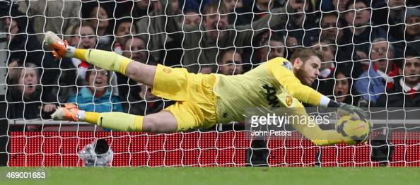 David de Gea of Manchester United makes a save during the Barclays Premier League match between Arsenal and Manchester United at Emirates Stadium on...
