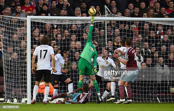 David De Gea of Manchester United makes a save from Enner Valencia of West Ham during the Barclays Premier League match between West Ham United and...