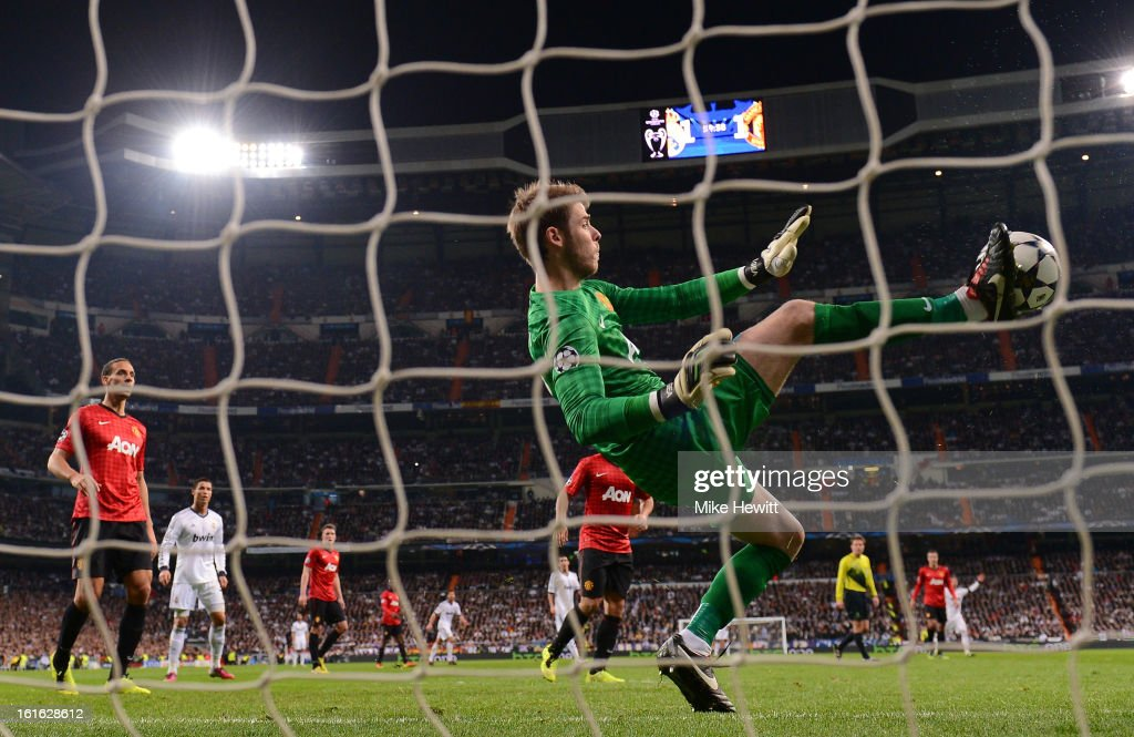 David De Gea of Manchester United makes a save with his foot during the UEFA Champions League Round of 16 first leg match between Real Madrid and Manchester United at Estadio Santiago Bernabeu on February 13, 2013 in Madrid, Spain.