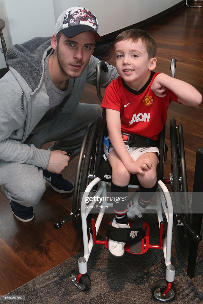 David de Gea of Manchester United meets Alex Nield during a Manchester United Foundation Dream Day, for fans with life-limiting illnesses, at Aon Training Complex on October 28, 2013 in Manchester, England.