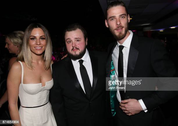 David de Gea of Manchester United poses with his partner Edurne Garcia and Game of Thrones actor John Bradley West at the annual United for UNICEF...