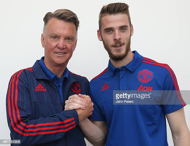 David de Gea of Manchester United poses with manager Louis van Gaal after signing a new fouryear contract at the club at Aon Training Complex on...