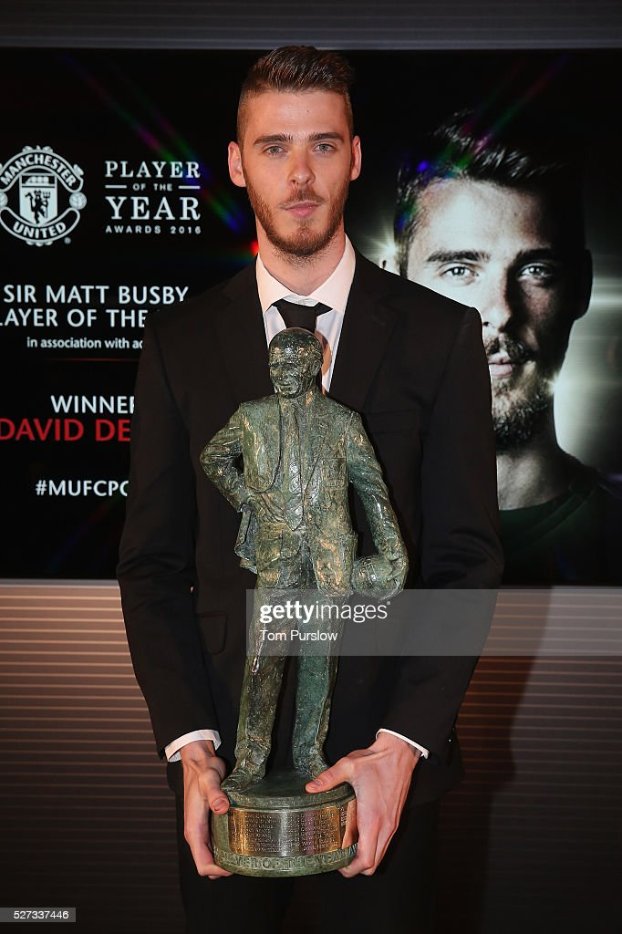 David de Gea of Manchester United poses with the Sir Matt Busby Fans' Player of the Season award by Manager Louis van Gaal at the club's annual Player of the Year awards at Old Trafford on May 2, 2016 in Manchester, England.