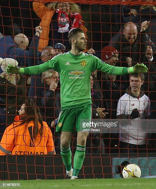 David de Gea of Manchester United reacts to conceding a goal to Roberto Firmino of Liverpool during the UEFA Europa League round of 16 first leg...