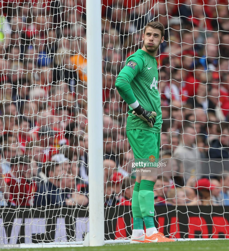 <a gi-track='captionPersonalityLinkClicked' href=/galleries/search?phrase=David+de+Gea&family=editorial&specificpeople=3000749 ng-click='$event.stopPropagation()'>David de Gea</a> of Manchester United reacts to conceding a goal to Sebastian Larsson during the Barclays Premier League match between Manchester United and Sunderland at Old Trafford on May 3, 2014 in Manchester, England.