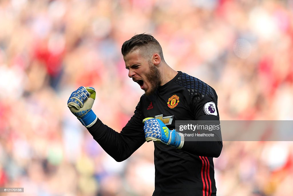 David De Gea of Manchester United reacts to the first goal being scored during the Premier League match between Manchester United and Stoke City at Old Trafford on October 2, 2016 in Manchester, England.