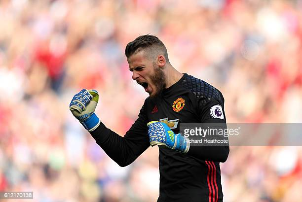 David De Gea of Manchester United reacts to the first goal being scored during the Premier League match between Manchester United and Stoke City at...