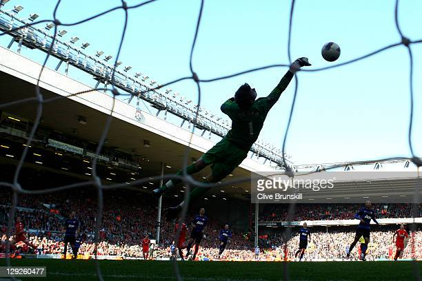David de Gea of Manchester United saves the attempt on goal of Jordan Henderson of Liverpool during the Barclays Premier League match between...