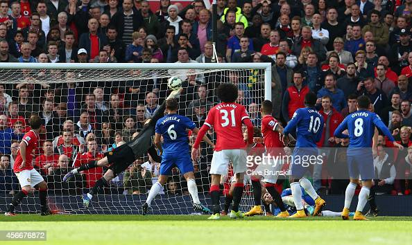 David De Gea of Manchester United saves the shot of Bryan Oviedo of Everton during the Barclays Premier League match between Manchester United and...