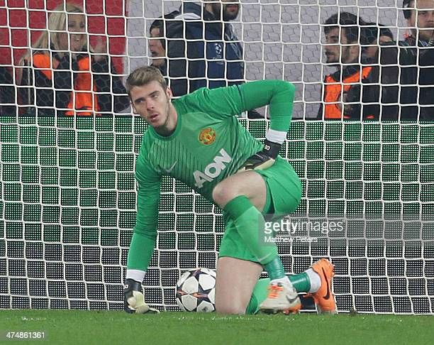 David de Gea of Manchester United shows his disappointment at conceding a goal to Joel Campbell during the UEFA Champions League Round of 16 match...