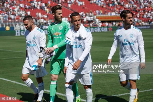 David de Gea of Manchester United walks off with Dani Carvajal of Real Madrid Lucas Vazquez of Real Madrid and Isco of Real Madrid at full time...