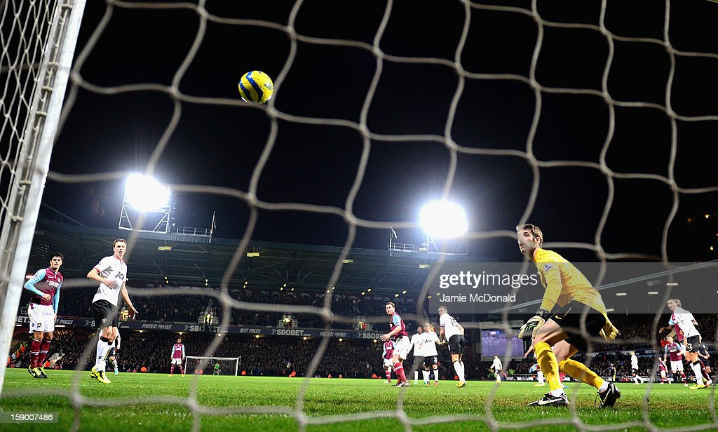 David De Gea of Manchester United watches the ball go over his head and into the net from a header by James Collins of West Ham United during the FA Cup with Budweiser Third Round match between West Ham United and Manchester United at the Boleyn Ground on January 5, 2013 in London, England.
