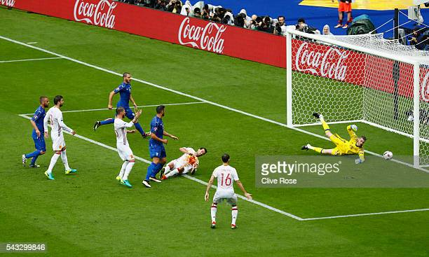 David de Gea of Spain makes a save during the UEFA EURO 2016 round of 16 match between Italy and Spain at Stade de France on June 27 2016 in Paris...