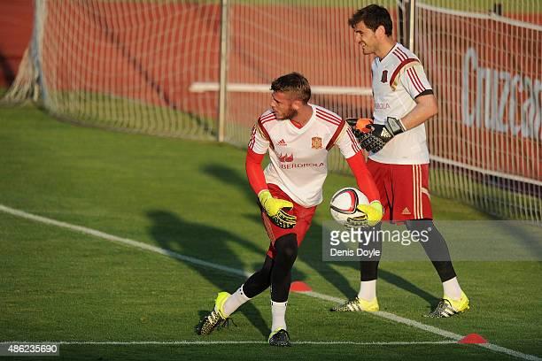 David de Gea throws the ball beside Iker Casillas during the Spain training session at Ciudad de Futbol on September 2 2015 in Las Rozas Spain