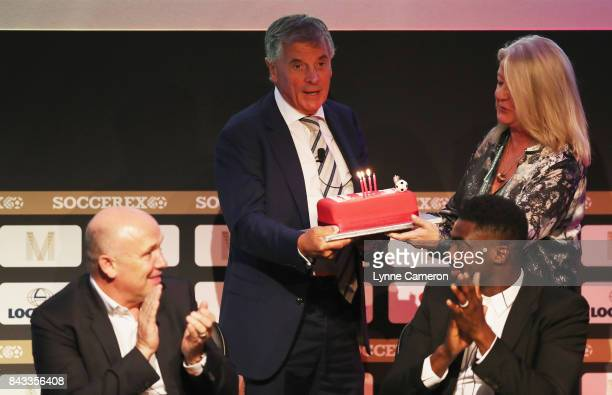 David Dein The FA former ViceChairman is presented with a Birthday cake by Rita Revie COO of Soccerex during day 3 of the Soccerex Global Convention...