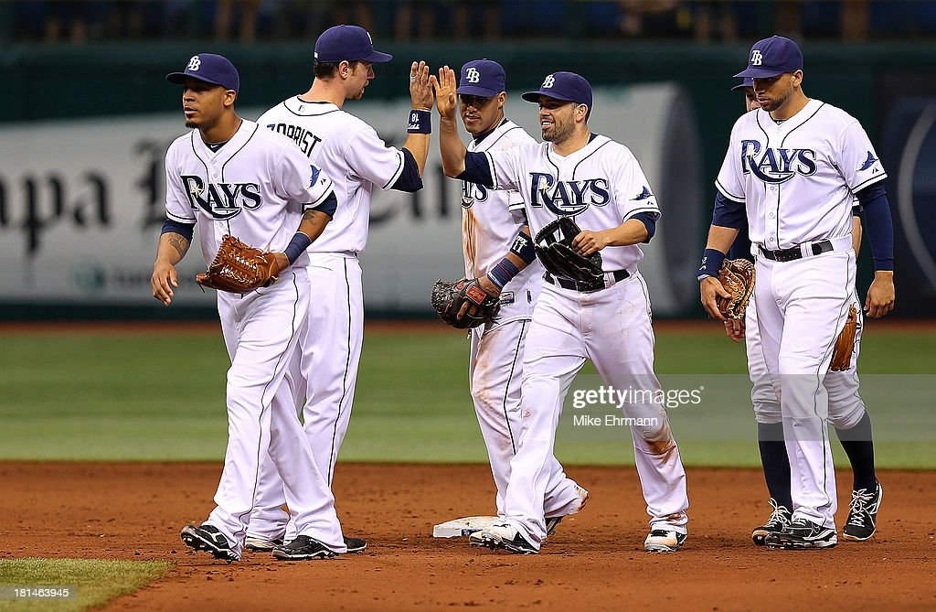 <a gi-track='captionPersonalityLinkClicked' href=/galleries/search?phrase=David+DeJesus&family=editorial&specificpeople=206765 ng-click='$event.stopPropagation()'>David DeJesus</a> #7 and <a gi-track='captionPersonalityLinkClicked' href=/galleries/search?phrase=Ben+Zobrist&family=editorial&specificpeople=2120037 ng-click='$event.stopPropagation()'>Ben Zobrist</a> #18 of the Tampa Bay Rays high five after winning a game against the Baltimore Orioles at Tropicana Field on September 21, 2013 in St Petersburg, Florida.