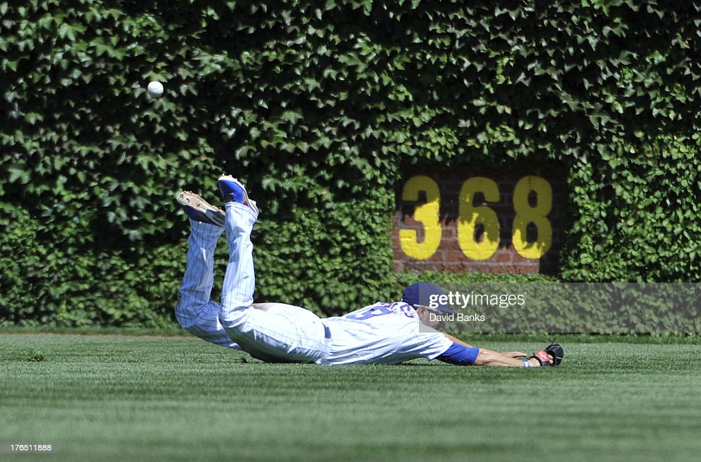 <a gi-track='captionPersonalityLinkClicked' href=/galleries/search?phrase=David+DeJesus&family=editorial&specificpeople=206765 ng-click='$event.stopPropagation()'>David DeJesus</a> #9 of the Chicago Cubs can't make a catch on a double by Ryan Hanigan #29 of the Cincinnati Reds during the fifth inning on August 14, 2013 at Wrigley Field in Chicago, Illinois.