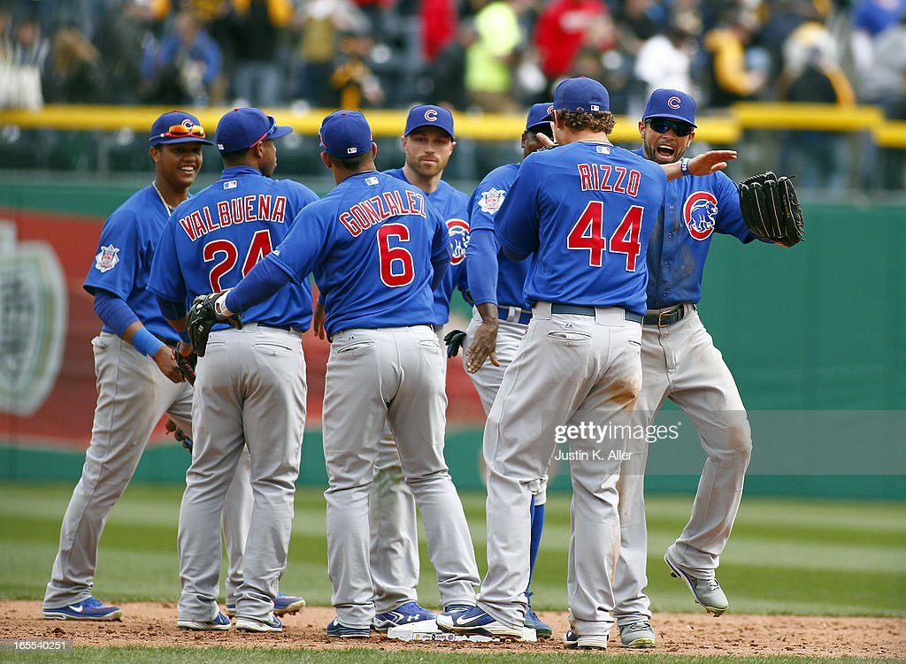 <a gi-track='captionPersonalityLinkClicked' href=/galleries/search?phrase=David+DeJesus&family=editorial&specificpeople=206765 ng-click='$event.stopPropagation()'>David DeJesus</a> #9 of the Chicago Cubs celebrates with teammates after defeating the Pittsburgh Pirates on April 4, 2013 at PNC Park in Pittsburgh, Pennsylvania. The Cubs defeated the Pirates 3-2.