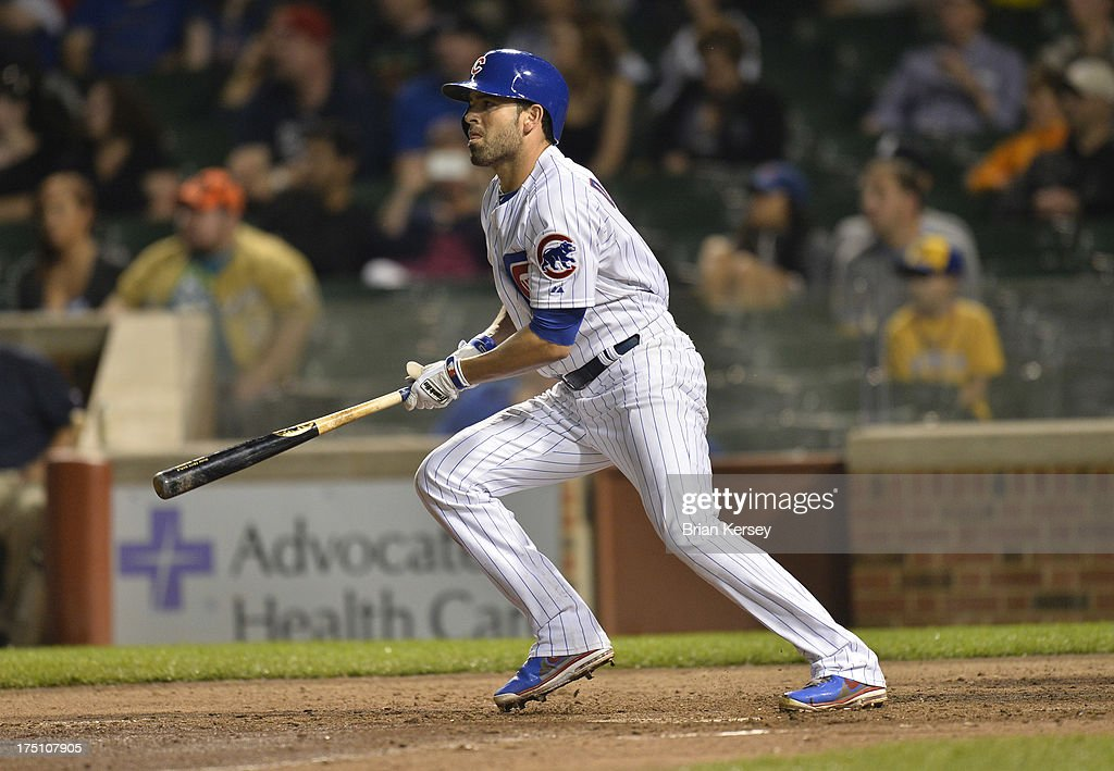 <a gi-track='captionPersonalityLinkClicked' href=/galleries/search?phrase=David+DeJesus&family=editorial&specificpeople=206765 ng-click='$event.stopPropagation()'>David DeJesus</a> #9 of the Chicago Cubs follows through on a two RBI single scoring teammates Welington Castillo #53 and Cody Ransom #1 during the sixth inning against the Milwaukee Brewers at Wrigley Field on July 31, 2013 in Chicago, Illinois.