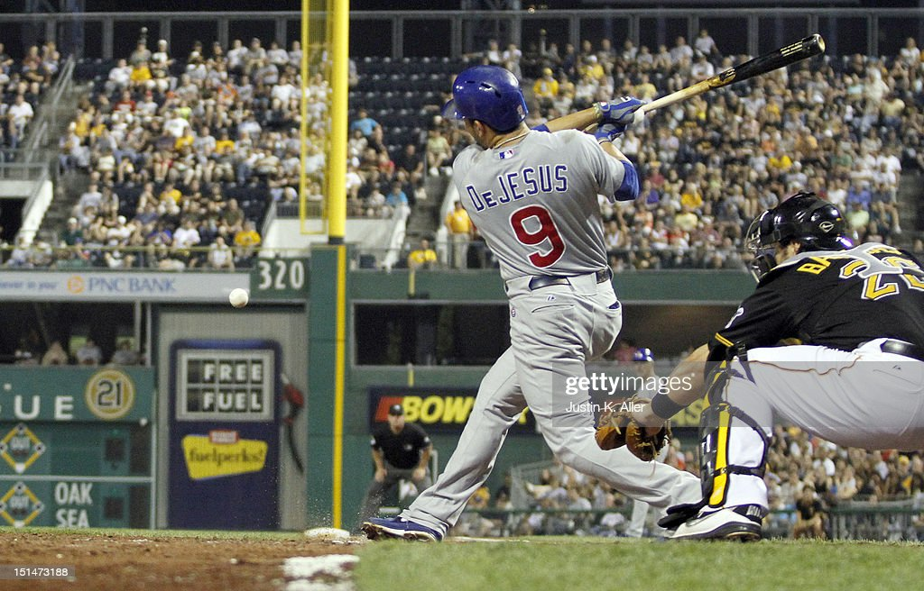 <a gi-track='captionPersonalityLinkClicked' href=/galleries/search?phrase=David+DeJesus&family=editorial&specificpeople=206765 ng-click='$event.stopPropagation()'>David DeJesus</a> #9 of the Chicago Cubs grounds into a fielder's choice, scoring Brett Jackson (not pictured) against the Pittsburgh Pirates in the sixth inning during the game on September 7, 2012 at PNC Park in Pittsburgh, Pennsylvania.