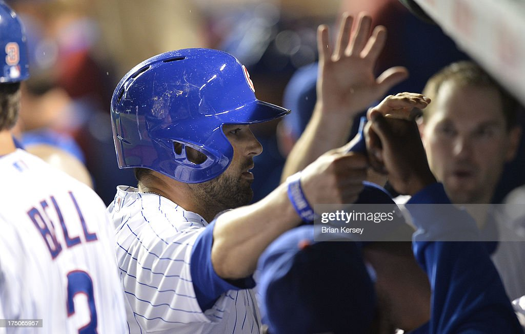 <a gi-track='captionPersonalityLinkClicked' href=/galleries/search?phrase=David+DeJesus&family=editorial&specificpeople=206765 ng-click='$event.stopPropagation()'>David DeJesus</a> #9 of the Chicago Cubs is congratulated in the dugout after the seventh inning of game two of a double header against the Milwaukee Brewers at Wrigley Field on July 30, 2013 in Chicago, Illinois. DeJesus hit an RBI double scoring teammates Cody Ransom #1 and Cole Gillespie #2 in the inning.