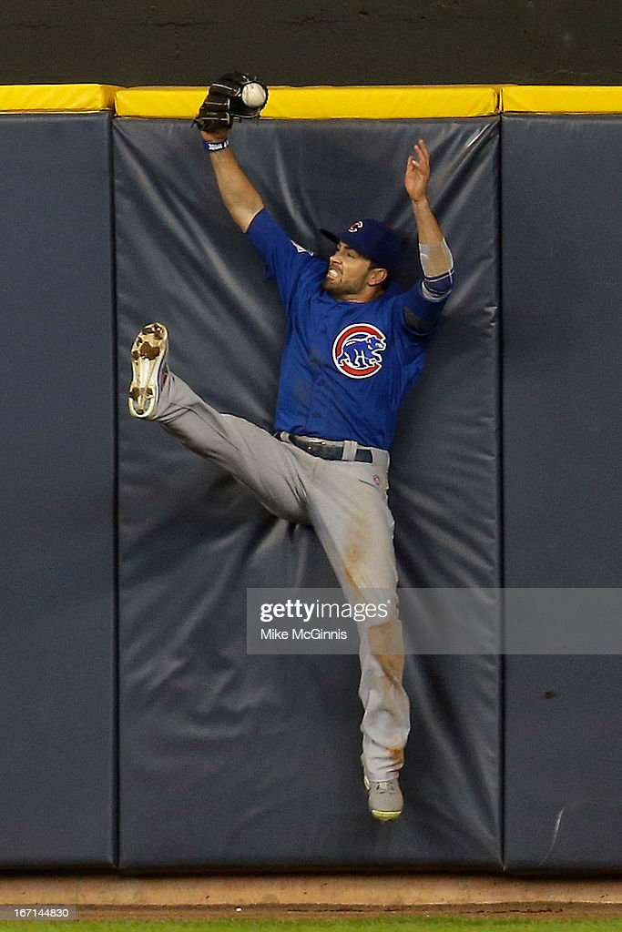David DeJesus #9 of the Chicago Cubs is unable to hold onto the is ball allowing Yuniesky Betancourt a double in the bottom of the fifth inning against the Milwaukee Brewers at Miller Park on April 21, 2013 in Milwaukee, Wisconsin.