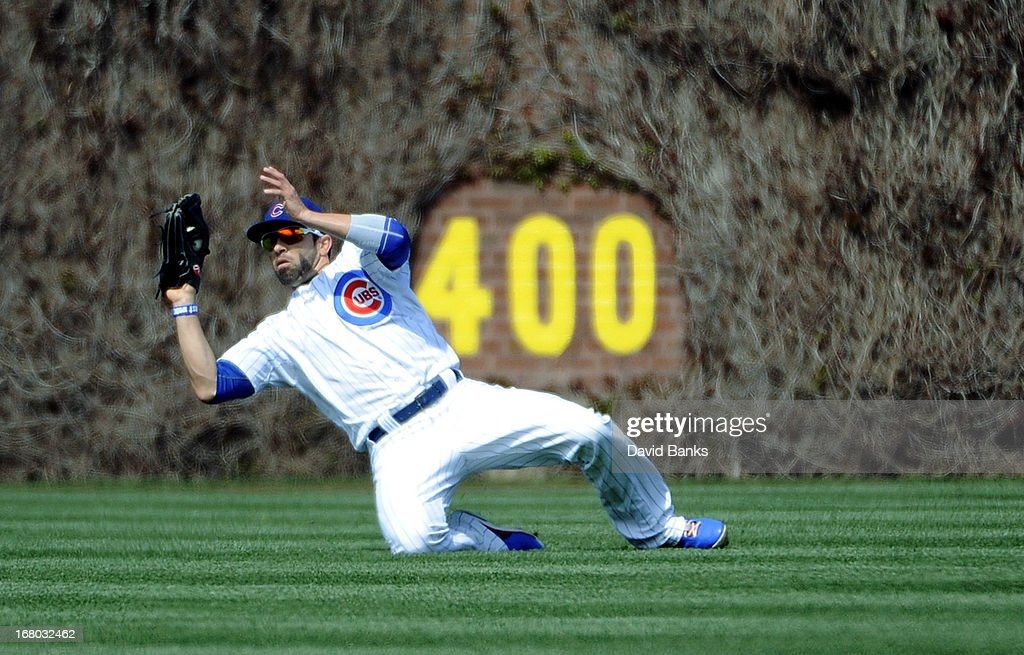 <a gi-track='captionPersonalityLinkClicked' href=/galleries/search?phrase=David+DeJesus&family=editorial&specificpeople=206765 ng-click='$event.stopPropagation()'>David DeJesus</a> #9 of the Chicago Cubs makes a catch against the Cincinnati Reds during the ninth inning on May 4, 2013 at Wrigley Field in Chicago, Illinois. The Cincinnati Reds defeated the Chicago Cubs 6-4.