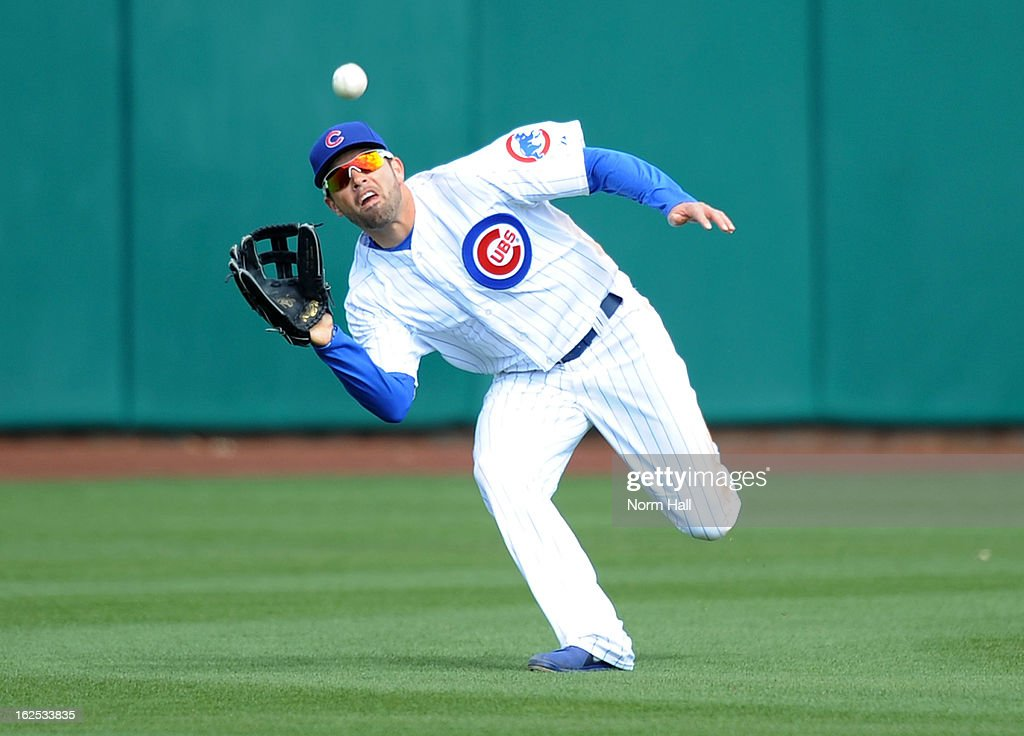 <a gi-track='captionPersonalityLinkClicked' href=/galleries/search?phrase=David+DeJesus&family=editorial&specificpeople=206765 ng-click='$event.stopPropagation()'>David DeJesus</a> #9 of the Chicago Cubs makes a diving catch against the San Francisco Giants at HoHoKam Park on February 24, 2013 in Mesa, Arizona.
