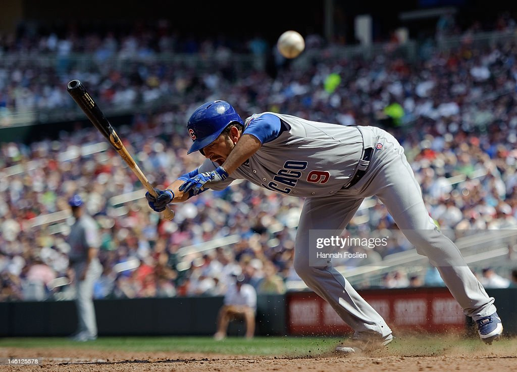 <a gi-track='captionPersonalityLinkClicked' href=/galleries/search?phrase=David+DeJesus&family=editorial&specificpeople=206765 ng-click='$event.stopPropagation()'>David DeJesus</a> #9 of the Chicago Cubs reacts after being hit by a pitch in the eighth inning against the Minnesota Twins on June 10, 2012 at Target Field in Minneapolis, Minnesota. The Cubs defeated the Twins 8-2.