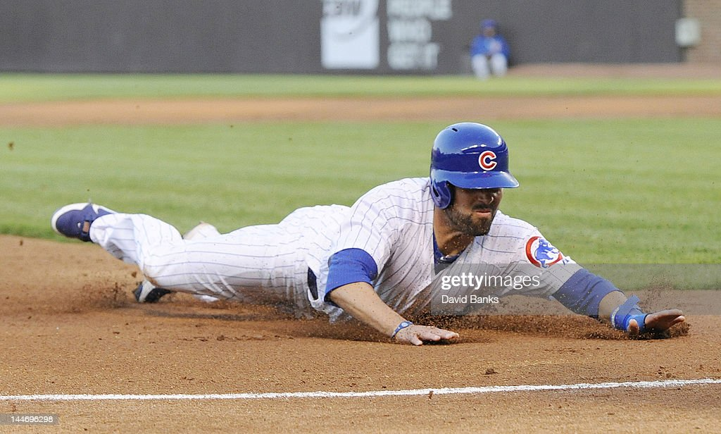<a gi-track='captionPersonalityLinkClicked' href=/galleries/search?phrase=David+DeJesus&family=editorial&specificpeople=206765 ng-click='$event.stopPropagation()'>David DeJesus</a> #9 of the Chicago Cubs slides safely into third base against the Philadelphia Phillies in the first inning on May 17, 2012 at Wrigley Field in Chicago, Illinois.