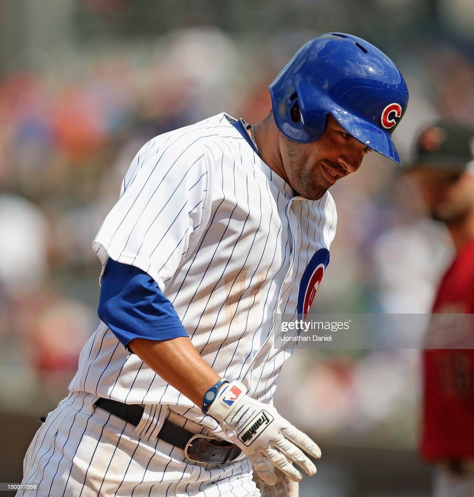 <a gi-track='captionPersonalityLinkClicked' href=/galleries/search?phrase=David+DeJesus&family=editorial&specificpeople=206765 ng-click='$event.stopPropagation()'>David DeJesus</a> #9 of the Chicago Cubs smiles as he runs the bases after hitting his second home run of the game, a two-run shot in the 4th inning, against the Houston Astros at Wrigley Field on August 15, 2012 in Chicago, Illinois.