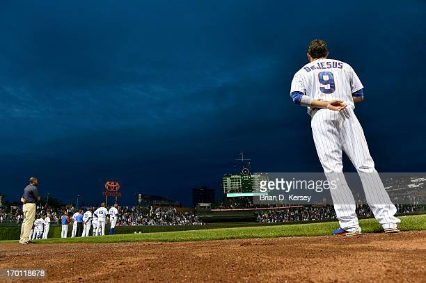 David DeJesus of the Chicago Cubs stands on the field during the singing of ''The Star Spangled Banner'' before the game against the Arizona...