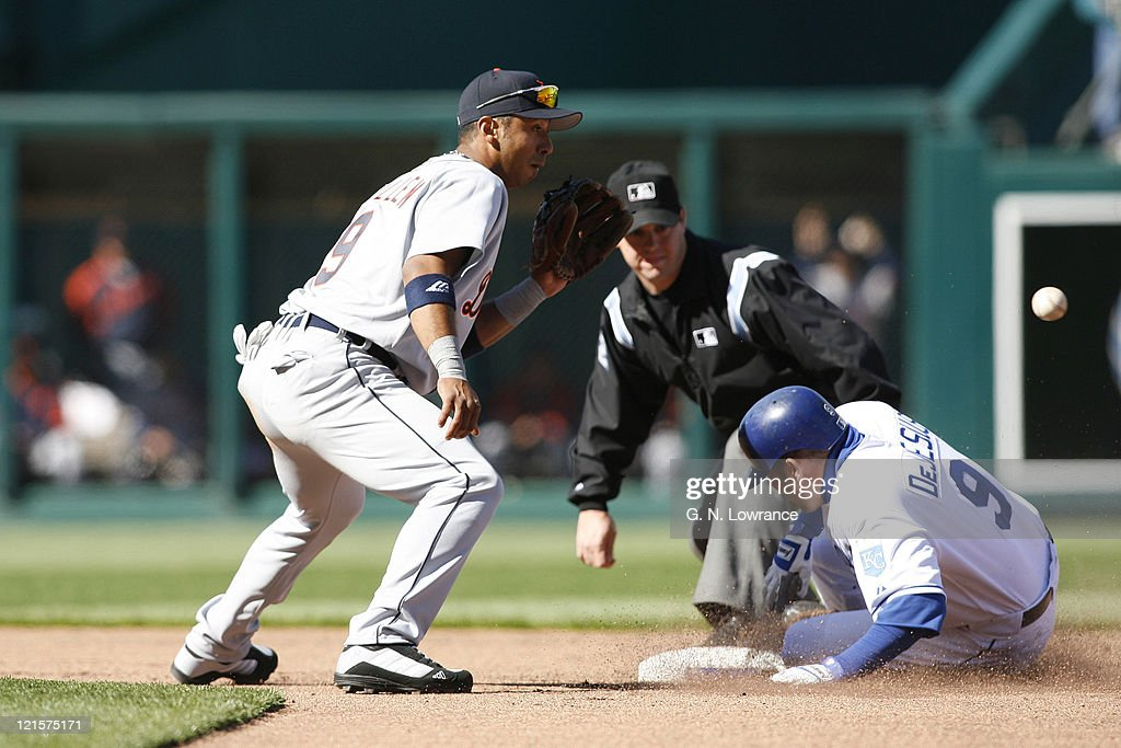 David DeJesus of the Royals slides in ahead of the throw to Carlos Guillen for a double during action on opening day against the Detroit Tigers at Kauffman Stadium in Kansas City, MO on April 3, 2006. Detroit won 3-1.